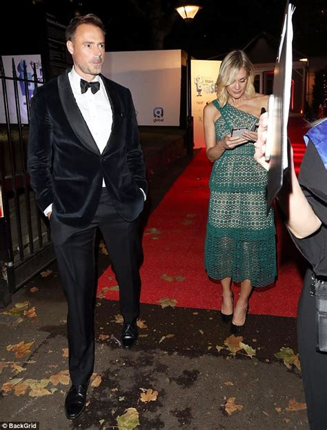 Jenni Falconer and Jamie Theakston caught holding hands