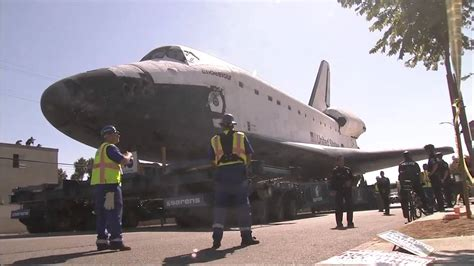 Space Shuttle Endeavour Traveling Through the Streets of